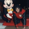 Michael at Disney World posing his hands in cement.