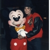 Michael posing hands in cement at Disney World