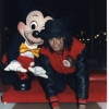 Michael posing hand in cements at Disney World.
